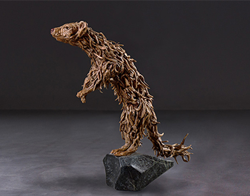 A pine marten reaches out for meaningful dialogue Long dead driftwood on a stainless steel armature mounted on a solid marble base Life size