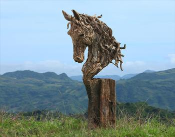 A driftwood and stainless steel sculpture of a bust of a thoroughbred