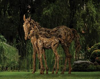 A Mare attends to her foal.Long dead driftwood on a stainless steel armature. Life size.